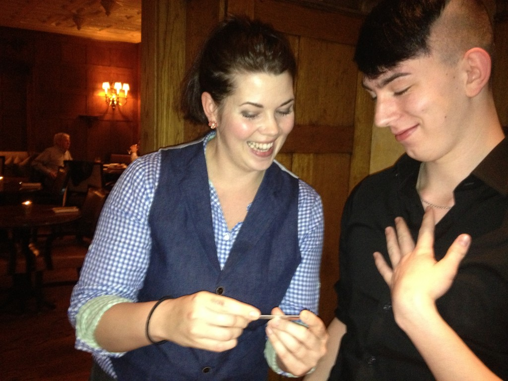 The beautiful bartender, Anna, cards Noah for the  first time at the Oak Bar, Hermitage Hotel.