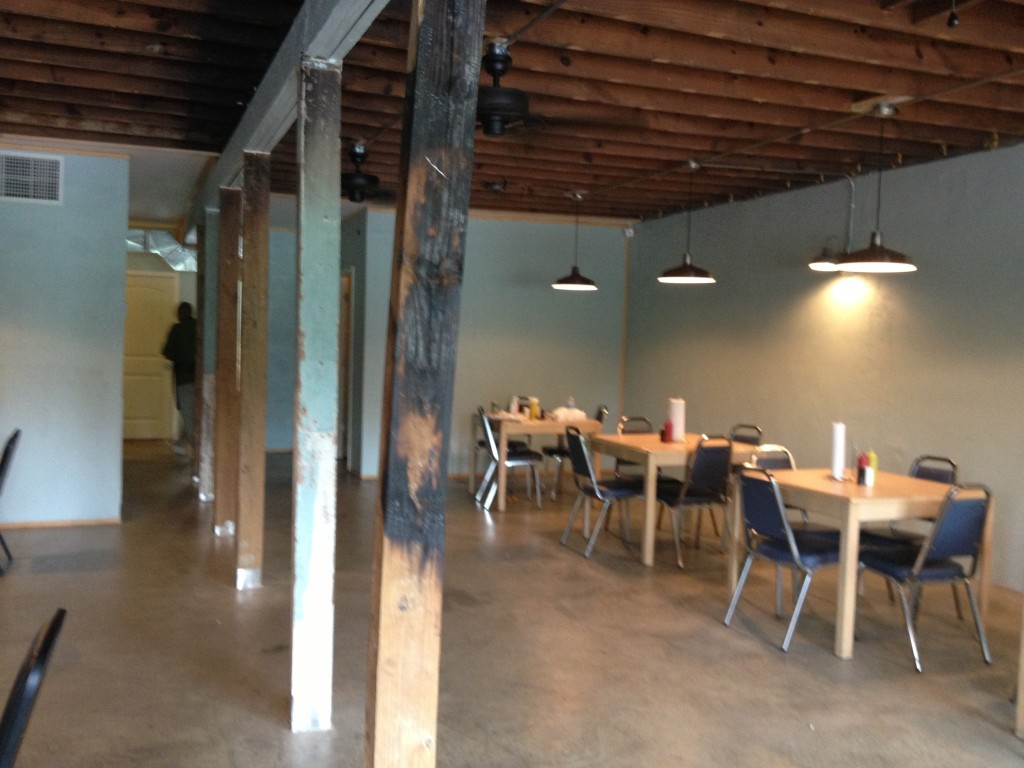 ...to a new spacious, air-conditioned dining room. Note the burned wood column - a reminder of the fire.