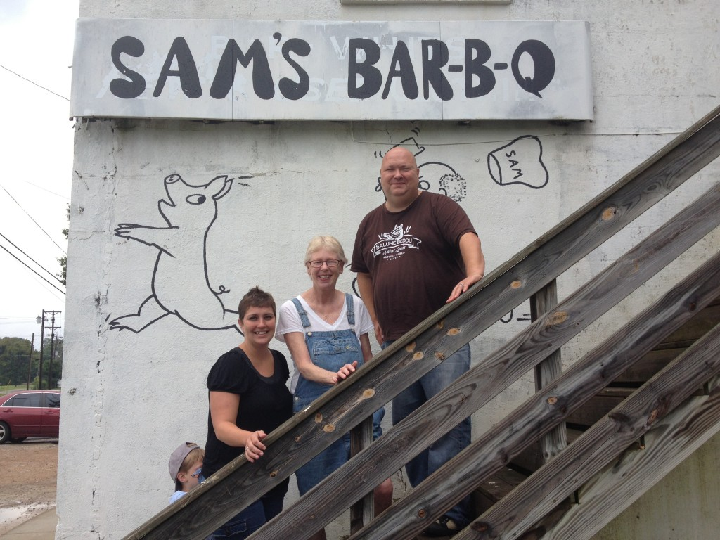 Tony, his beautiful wife Jennifer and I in front of the newly painted Sam's sign.