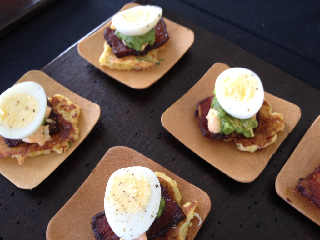 Crispy corn cakes with jalapeno bacon, pimento cheese, quail egg and collard green pesto from The Southern Steak and Oyster