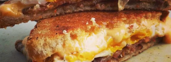 Grilled bacon, egg and pimento cheese sandwiches